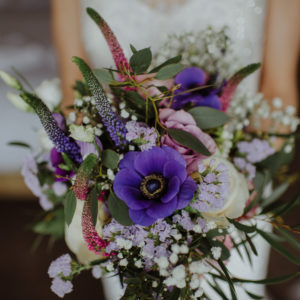 Purple spring wedding bouquet rustic and wild
