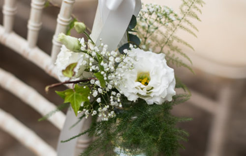 Chair end pew end wedding flowers