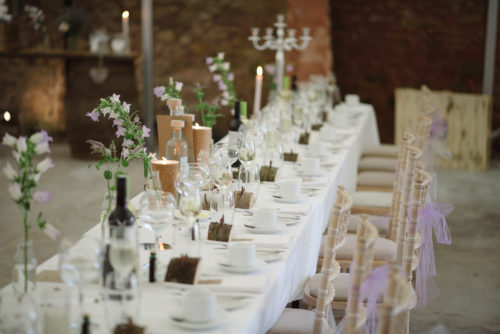 Bottles of flowers centrepieces