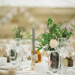 Greenery bottles table flowers centrepieces