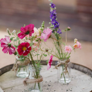 Bright summer flowers in jars