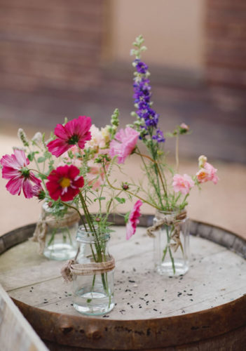 Bright summer flowers in jars