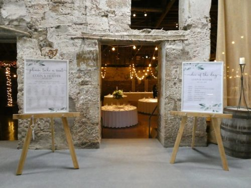 Order of the Day and Table Plan on Rustic Easels