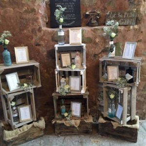 Bottles of flowers in rustic display Prop Hire Wedding Scotland