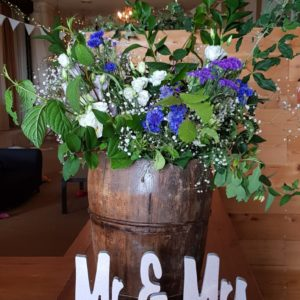 Wild flowers in vintage wooden milk churn display prop hire Scotland