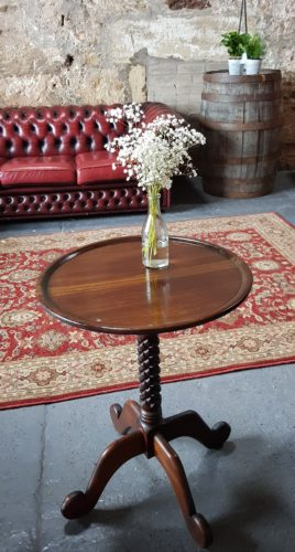 Round Antique Side Table with flowers