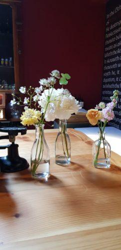 Bottles of seasonal flowers
